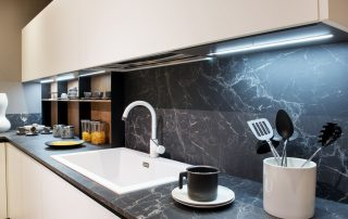 Bold,Backsplash, Marble,Effect,Kitchen,Counter,With,Utensils,And,A,White,Rectangular