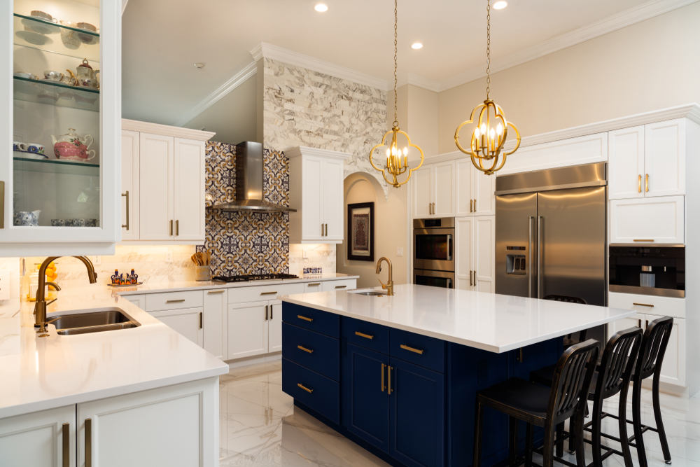 kitchen with white cabinets and blue island