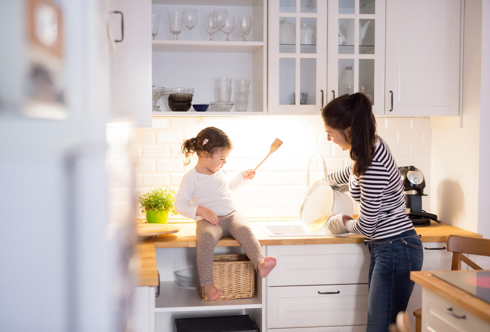 Family cooking in remodeled kitchen - 5 Kitchen Remodeling Tips for Your Forever Home